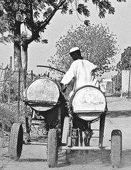Carrying water (1985) (pedrosimoes7) Tags: pessoas water carryingwater alltypesoftransport khartoumoutskirtssudan blackandwhite blackwhite blackwhitepassionaward blackandwhiteonly