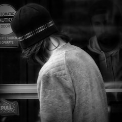 Hard Expression / Provocant (H - - J) Tags: blackandwhite monochrome monotone man cap sweater door cafe beard hair outdoors glass window noiretblanc street homme people touque