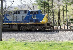 CSX GE CW44AC diesel electric locomotive # 215 is leading a unit coal train as it enters the south end of the yard at Erwin, Tennessee, 4-15-2008 (alcomike43) Tags: csx clinchfieldrailroad erwintennessee erwinyard railroadyard trains railroads scenic countryside mountains tracks rightofway rails weldedribbonrail ties tieplates spikes ballast roadbed mainline ge generalelectric cw44ac 215 222 engines locomotives diesels dieselengine diesellocomotive dieselelectriclocomotive radialsteerabletrucks actractionsystem photo photograph color digitalimage