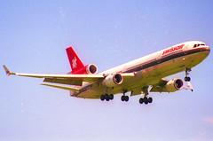 Swissair Asia MD-11; HB-IWL@ ZRH;28.05.1995 (Aero Icarus) Tags: zrh zürichkloten zürichflughafen zurichairport lszh plane avion aircraft flugzeug negativescan
