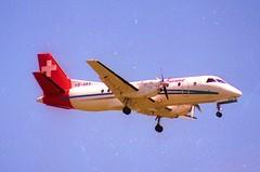 Crossair Saab 340B; HB-AKK@ZRH;28.05.1995 (Aero Icarus) Tags: zrh zürichkloten zürichflughafen zurichairport lszh plane avion aircraft flugzeug negativescan