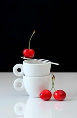 It's All About Balance (njk1951) Tags: balance cups whitecups espressocups cherries red redcherries spoon stilllife threecherries blackwhitebackground springcherries fruit tabletopphotography reflections