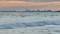 Portsmouth from East Wittering (Williams5603) Tags: sunset beach westsussex portsmouth spinnakertower witterings eastwittering longexposure waves d5100 surf hampshire skyline skyscraper