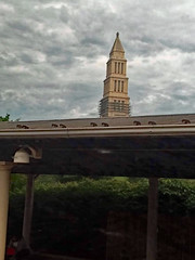 Alexandria, Virginia Amtrak Station. (dccradio) Tags: alexandria va virginia fairfaxcounty sky clouds cloudy overcast monument georgewashingtonmasonicmonument museum tower station depot amtrakstation amtrak palmetto light pole awning roof greenery tree trees photooftheday photo365 project365 outdoor outdoors outside spire steeple june summer summertime saturday weekend saturdaymorning morning goodmorning samsung galaxy smj727v j7v cellphone cellphonepicture
