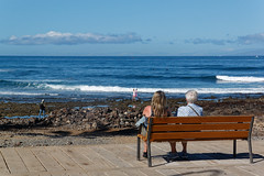 Los Cristianos, Tenerife, Canary Islands (wildhareuk) Tags: beach canaryislands canon canoneos500d people seascape spain tamron18270mm tenerife tenerife2019 bench loscristianos pebble tamron img9398dxo