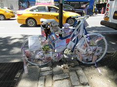 2019 Ghost Bike on Central Park West NYC 1784 (Brechtbug) Tags: 2019 ghost bike death central park west green light pole tribute bicycle accident victim sidewalks flowers stickers note pavement new york city nyc memorial rip wings street art memorials mark sites of victims who were killed in traffic june 06152019 uptown side manhattan