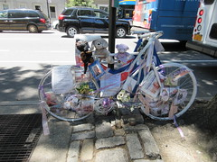 2019 Ghost Bike on Central Park West NYC 1783 (Brechtbug) Tags: 2019 ghost bike death central park west green light pole tribute bicycle accident victim sidewalks flowers stickers note pavement new york city nyc memorial rip wings street art memorials mark sites of victims who were killed in traffic june 06152019 uptown side manhattan