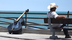 Malecón (thomasgorman1) Tags: bass acoustic bassist bassplayer bench beach malecon nikon shore baja mexico travel man sitting candid public street streetphotos streetshots cowboy hat sea cortez