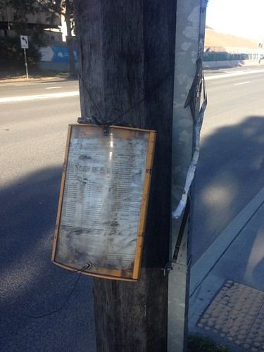 Destroyed bus stop timetable on Canal Road, Mascot