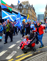 Scotland West Highlands Argyll the Oban Scottish Independence march a happy mother giving the victory sign 15 June 2019 by Anne MacKay (Anne MacKay images of interest & wonder) Tags: scotland west highlands argyll oban scottish independence march happy mother flag flags sreet people town buildings 15 june 2019 picture by anne mackay auob