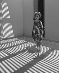 Girl in shadow stripes (Oleg Kr) Tags: greece mycenae panasonic1232mmf3556 blackandwhite children shadowplay shadows