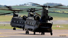 """ZA720 and ZH892  RAF CH47 """"Onslaught Formation"""" departing Prestwick in a clutter of blades,jelly and heat haze after a hot refuel (arrived from Leuchars). 24/5/19 (BS Images.) Tags: royalairforce raf military helicopter chinook ch47 za720 zh892 aircraft airport aviation ayrshire egpk glasgowprestwick gpa prestwick prestwickairport pik southayrshire scotland"""