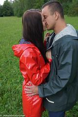 Meeting a shiny red cutie (38 pics) (sexyrainwear_dot_online) Tags: raincoat rainwear pvc vinyl lack regenmantel regenjacke