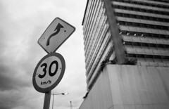 Road sign (Manuel Goncalves) Tags: road street blackandwhite roadsign nikonfg20 nikkor28mm fujineopanacros100 epsonv500scanner brazil santos 35mmfilm analogue