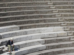 Audience of one (shaggy359) Tags: italy pompeii campania ruin ruins roman large theatre theater curve curved seat seats seating ranked step steps person man hat sole single alone spectator viewer audience