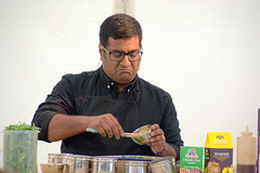 A demonstration from Rafi's Spicebox whose York shop on Goodramgate specialises in curry kits - 3 (Tony Worrall) Tags: yorkfoodfestival2019 york food festival 2019 spice asian show event stage demo fun cookery cooking display rafi'sspicebox rafi's spicebox curry make kevinfernandez yorkshire north update place location uk england visit area attraction open stream tour country item greatbritain britain english british gb capture buy stock sell sale outside outdoors caught photo shoot shot picture captured ilobsterit instragram