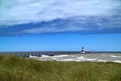Tiscornia Beach, St. Joseph (mswan777) Tags: beach shore coast wind weather waves water grass pier lighthouse sky cloud blue green white horizon apple iphone iphoneography mobile st joseph michigan