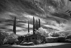 uncertainty reigns (Robert Couse-Baker) Tags: infrared clouds suburban bw nb sacramento sky street