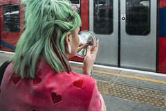 RGB (markfly1) Tags: red green blue transport train classic tube london underground woman sitting bench behind screen make up cosmetic mirror eyelashes checking falsies hair dress love hearts hands candid image street photography doors windows pink yellow lines platform edge nikon d750 35mm manual focius lens