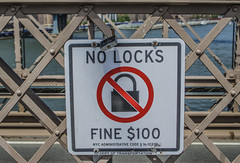 No One Follows the Rules Anymore (Paul B0udreau) Tags: newyorkcity nyc usa photoshop canada ontario paulboudreauphotography niagara d5100 nikon nikond5100 raw layer commuter bridge eastriver nikkor1855mm dumbo brooklyn brooklynbridge sign bylaw red lock