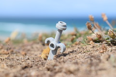 """""""A Sword in the ground"""". (Working hard for high quality.) Tags: mud grass object sword lego sea focus"""