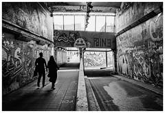 One-Sided (Adam Lee Guitarist) Tags: london londoner explore exploration explored explorer couple pair people human humans person man woman street graffiti art noir social documentary photojournalism photography film kodak trix 400 rodinal 1100 leica m6 7artisans 28mm f14 14 asph aspherical m rangefinder camera streets is dead