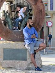 sitges (gerben more) Tags: handsomeman man statue hand child streetscene street spain people portrait portret beard sitges
