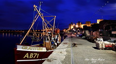 Gratitude (Peter.S.Roberts) Tags: interesting gratitude conwy north wales northwales docks boats castle conwycastle longexposure blue bluehour seascape landscape outdoor night evening late boat ship vessel fishingboat dockside moorings boxes lobsterpots fishingport lights lighting illumination streetlights rigging masts sea water river harbour harbor riverconwy afonconwy welsh cymru reflections shadows colours colourful historic turrets walls sky clouds perspective details dof pov composition buildings ropes fishingnets petersroberts ab71 june142019 flickr