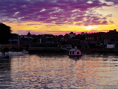 Sunset and silhouettes (Mellisapix) Tags: harbourarm uk sillhouettes reflection coast boathouse pinkhouse colourful sky orange pink light sparkle shimmering boats ocean sea harbour water street houses sunset