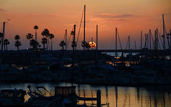 Setting sun over the harbor in Oceanside California (Gail K E) Tags: oceanside oceansideharbor california pacificocean usa sunset harbor marina pacific beautiful