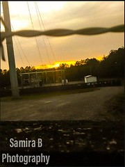 Distant Sunset (Samira B Photography) Tags: sunset sun fence road perspective gravel powerline powerplant trees walk