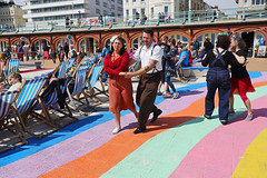 Brighton Jazz on the Prom (Finding Chris) Tags: chrisbarbaraarps findingchris visualstorytelling brightonandhove eastsussex jazzfestival promenade promenading rainbowpathway dancers deckchairs arches canonmirrorless canonr canon24105
