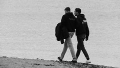 Sunday at Porty 04 (byronv2) Tags: portobello edinburgh sea northsea forth firthofforth riverforth rnbforth rnbfirthofforth beach edimbourg scotland river coast coastal street candid peoplewatching man couple walking blackandwhite blackwhite bw monochrome