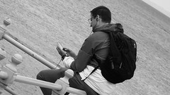 Sunday at Porty 011 (byronv2) Tags: portobello edinburgh sea northsea forth firthofforth riverforth rnbforth rnbfirthofforth beach edimbourg scotland river coast coastal street candid peoplewatching phone cellphone mobilephone man blackandwhite blackwhite bw monochrome