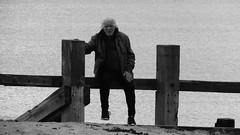 Sunday at Porty 02 (byronv2) Tags: portobello edinburgh sea northsea forth firthofforth riverforth rnbforth rnbfirthofforth beach edimbourg scotland river coast coastal street candid peoplewatching man seat seated sitting fence blackandwhite blackwhite bw monochrome