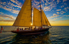 The Sun is Also a Star (KC Mike Day) Tags: west key sunset sailing sailboat water gulf mexico atlantic ocean waves stern bow people keys florida east coast mainsail jib windward lines hull keel rigging