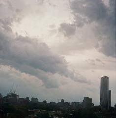 Clouds (Tom Ipri) Tags: fmctower mediumformat pentaconsix filmisnotdead philly filmphotography lomographycolornegative100 philadelphia shotonfilm clouds 120film