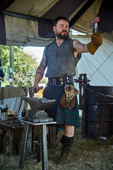 """Turner Forge """"Turning Fire into Art, Tools & Weapons"""" - Oregon Renaissance Faire (coljacksg) Tags: add tags cider oregon renaissance faire fair sony a7r vintage vivitar 28200mm f35 kobori zoom lens actors cosplay medieval middle ages blacksmith turner forge anvil handmade axe port orchard washington live tool making decorations art"""