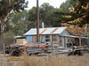 House with Wood Stacks (mikecogh) Tags: myponga house basic wood piles planks stobiepole rust