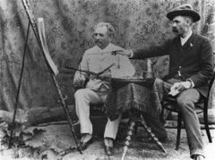 Two unidentified artists discussing an art work (State Library of Queensland, Australia) Tags: queensland statelibraryofqueensland artists painters studioportrait spats moustaches easel paintbrushes