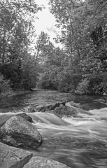 The Creek rushes by (J. Gillis Photography) Tags: photography peterborough peterboroughontariocanada peterboroughontario outdoor outdoorphotography water blackandwhite blackandwhitephotography bwphotography creek jacksonpark jacksonparkcreek ontario ontariocanada canon canada canonrebel canont6 canonrebelt6