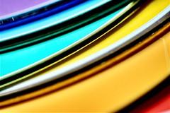 Curves (helensaarinen) Tags: curves macromondays rainbow macro cds rounded