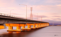 The 84 (g-liu) Tags: road bridge architecture water longexposure smooth sunset orange red color powerlines concrete goldenhour paloalto california highway travel cloudy clouds sony a6500 naturallight poles manmade usa america dumbartonbridge