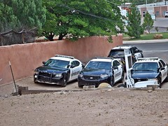 One of each . 6/16/2019 (THE RANGE PRODUCTIONS) Tags: dodge ford police cop car unit squad partol vehicle sierracountynm southwestus smalltownsouthwest newmexico desert wall