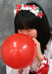 She Is Wanting More Red. (emotiroi auranaut) Tags: air girl woman lady nice pretty beauty beautiful model clothing bonnet face hair red toy balloon blow blowing grow growing bigger expanding strawberries strawberry eyesclosed trying concentrating breathe breathing blowingupaballoon