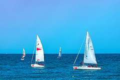 Let us learn (Fnikos) Tags: sea mar mare water wave serene seascape boat sailboat ship sky cielo skyscape people colour color colors colores blue blu blau azul sport sports deporte deportes outdoor outside