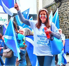 Scotland West Highlands Argyll the Oban Scottish Independence march a happy lassie 15 June 2019 by Anne MacKay (Anne MacKay images of interest & wonder) Tags: scotland west highlands argyll oban scottish independence march happy lady lassie people flags flag street 15 june 2019 picture by anne mackay auob