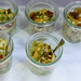 Vegetarian pasta salad with broccoli, mushrooms, dried tomatoes and pine nuts in small jars at the BarCamp in Bonn