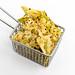 Vaya Bean Salt Snack von Zweifel, mit Erbsen, schwarzen Bohnen, Reismehl und Kichererbsen, als gesunder, veganer Snack, in einem kleinen Frittierkorb.