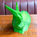 Close-up of a green rabbit created through 3D printing photographed from the front